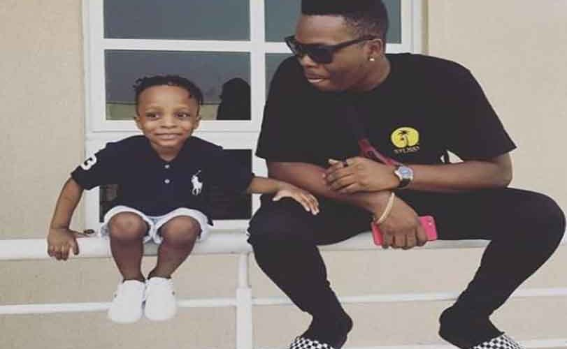 Photos: Olamide shows off his 3-year old son with a new hairstyle