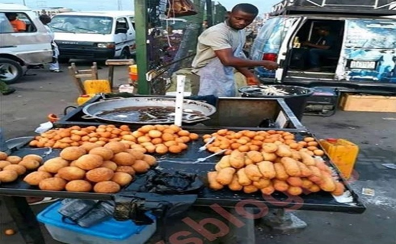 See The University Graduate Who Is A 'Puff Puff' Seller (Photos)
