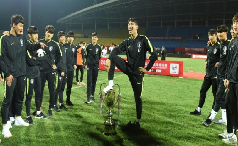 China strips South Korea of football trophy for 'indecent' celebrations
