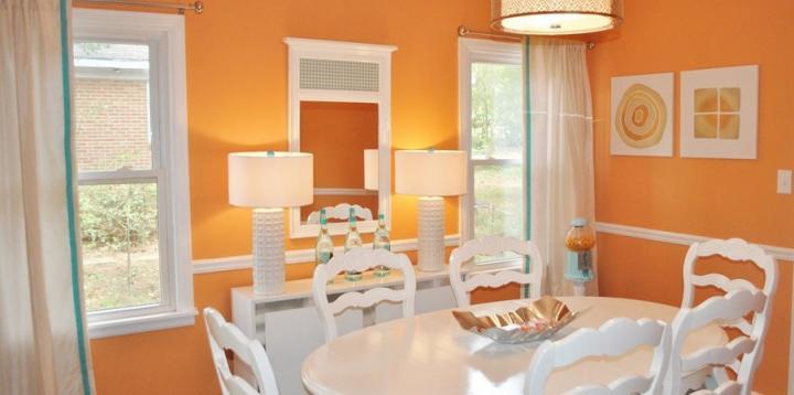 Decoração de sala com a cor laranja
