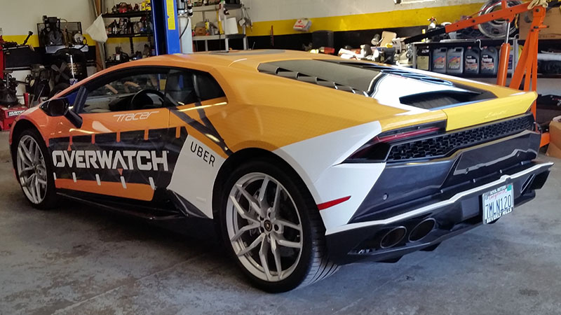 An exotic car wrapped in the style of Tracer from Overwatch.