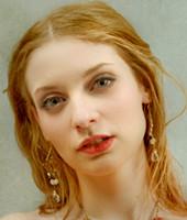 Headshot of Ela Darling