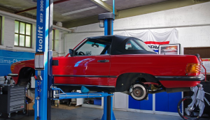 car on lift in workshop