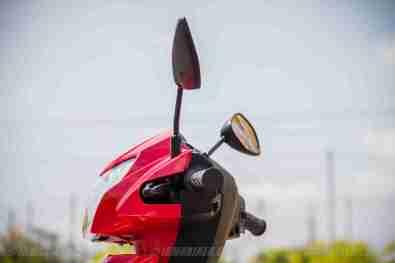 Suzuki Lets scooter headlight left view