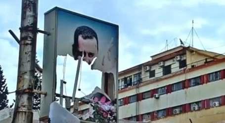 تمزيق صور لبشار الأسد في شرق دمشق والسلطة ترد