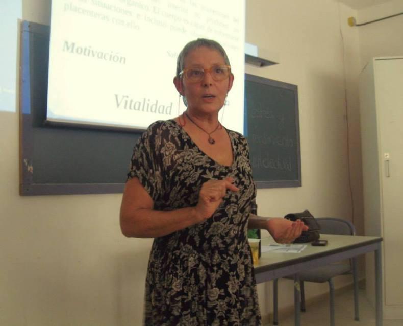 Photo of Miriam giving a holistic life coaching presentation