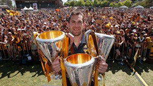 Luke Hodge the captain with three grand final trophies (click to enlarge or to source, then back-arrow to return to blog).