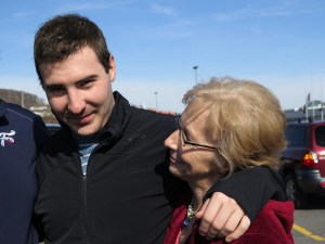 Nikko Adam, 22, gets a hug from his mother, Patti Trabosh, after his family picked him up from his sober living facility for a weekend outing. Source: Melissa Block/NPR