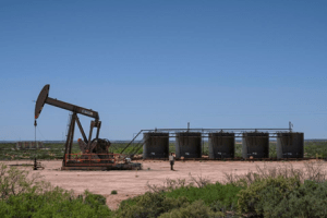 A pump jack operates on April 23, 2020 Eddy County, New Mexico. - Permian Basin Crude oil extraction