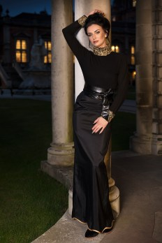 Ana Maria in black and gold in the quadrangle at Royal Holloway