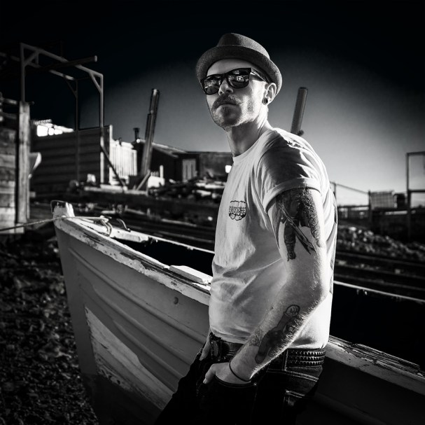 Infra red shot of Cameron leaning against a fishing boat