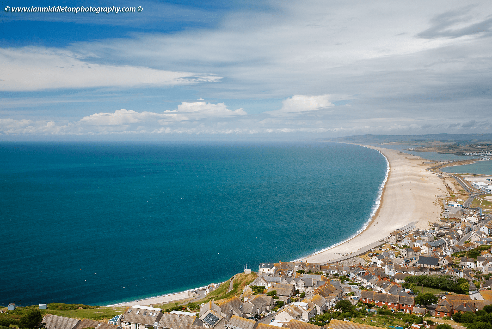 View across Chesil Beach from Portland Heights, Dorset, UK.
