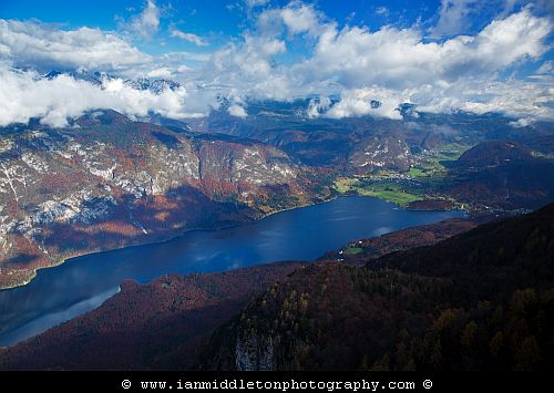 Beautiful light and clouds scattering over Bohinj Lake in autumn, seen from Vogel Mountain ski resort, Triglav National Park, Slovenia.