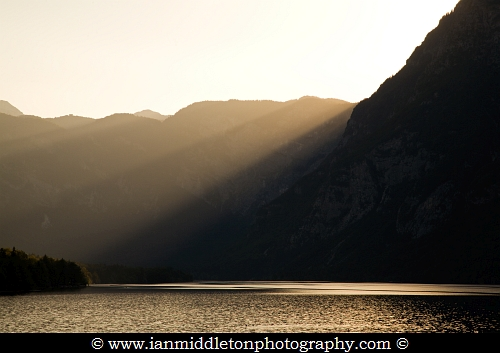 Alpine rays of light over Lake Bohinj at sunset , Triglav National Park , Slovenia