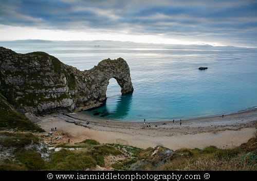 Durdle Door beach as the afternoon cloud breaks up, Dorset, England. Durdle door is one of the many stunning locations to visit on the Jurassic coast in southern England.