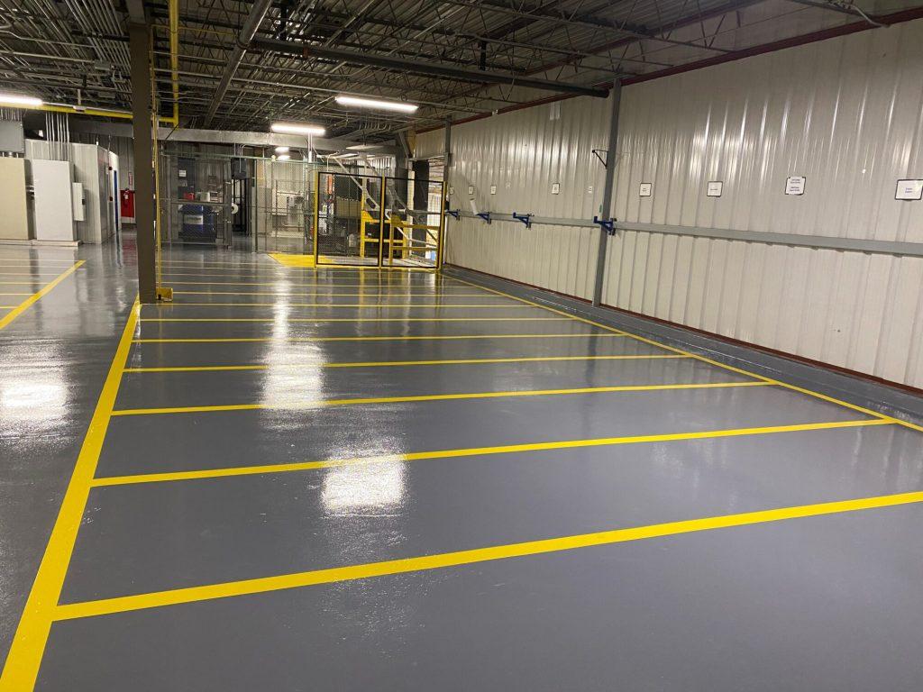 Concrete floor coatings, epoxy floor coatings, epoxy coatings, Industrial Applications Inc, TeamIA, epoxy floor coating, industrial concrete floors, epoxy safety striping, 5S safety, epoxy line striping