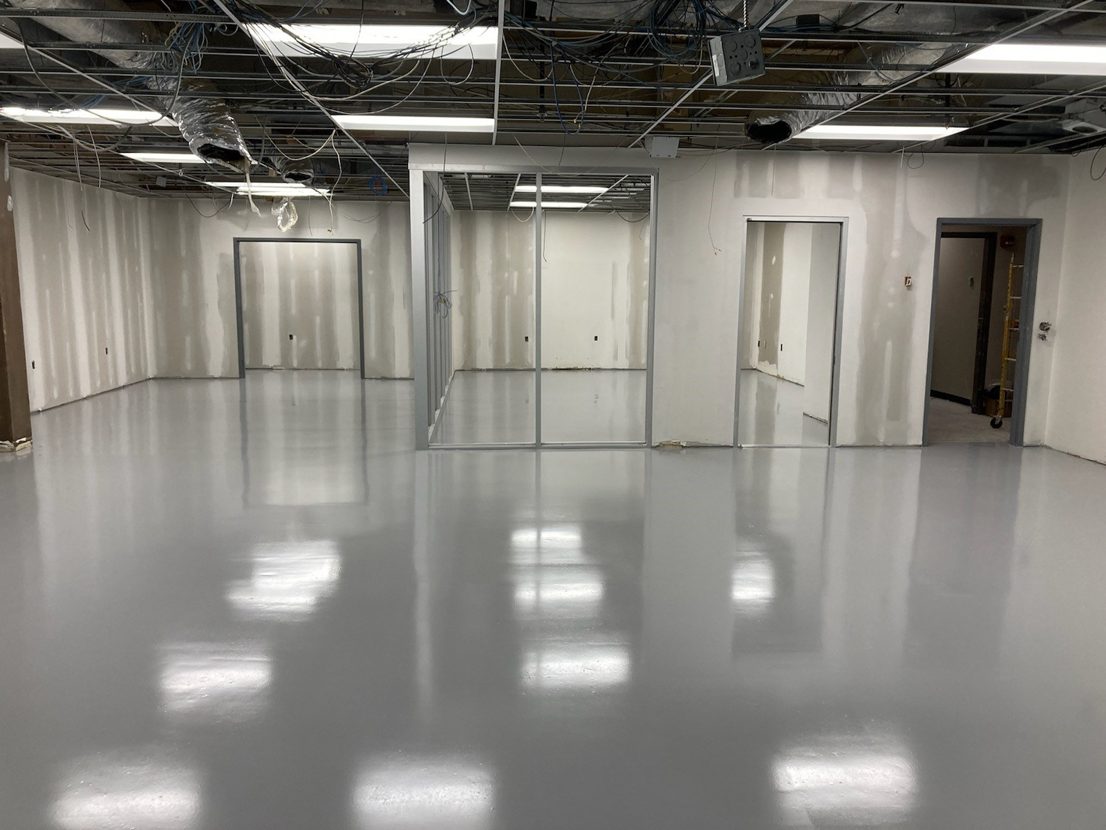 concrete floor resurfacing, flooring contractors Collierville TN, TeamIA, Industrial Applications Inc., epoxy floor coatings, manufacturing flooring, Collierville TN
