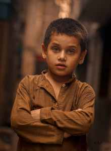 photo of boy wearing brown long sleeves