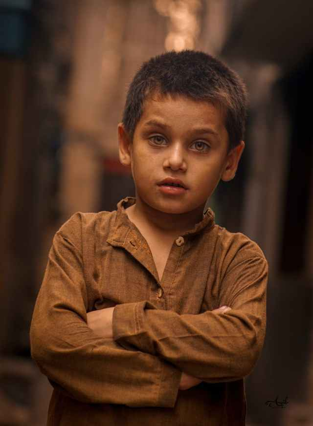 photo of boy wearing brown long sleeves