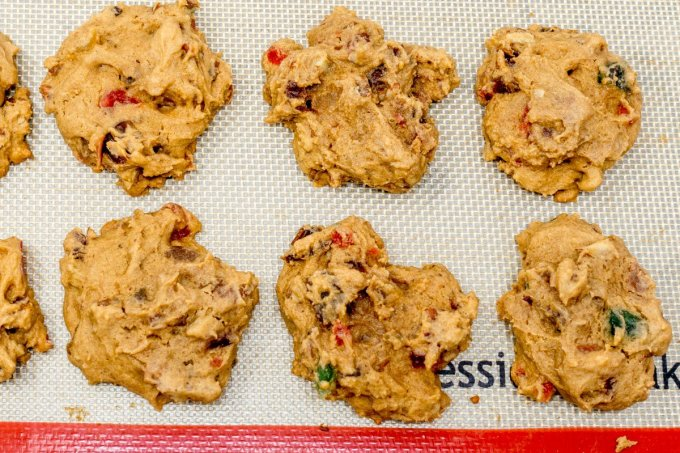 Drop the candied fruit cake cookie batter onto a silicone baking sheet so it won't stick