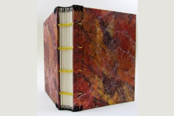 slim coptic binding on marbled boards