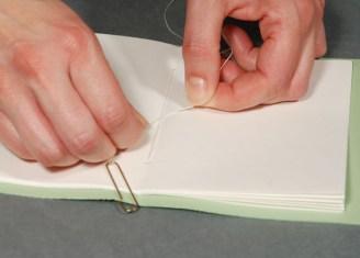 Securing-Binders-Thread-on-Book-Block