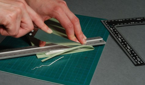 Using-Knife-to-Trim-Excess-Materials-off-Book