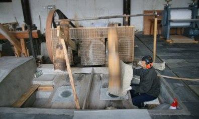 beating tree bark to make Xuan paper in China