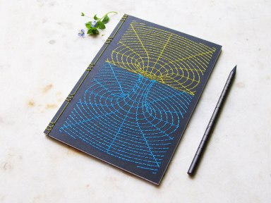 embroidered-notebooks-worm-hole-yellow-blue-on-notebook