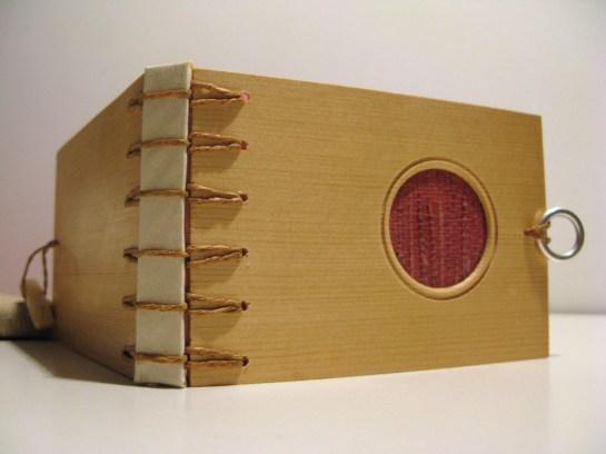 Ask Ida Wooden Natural Crisscross Binding - http://www.bookbindingteam.com/2011/02/2011-winter-swap-askida.html