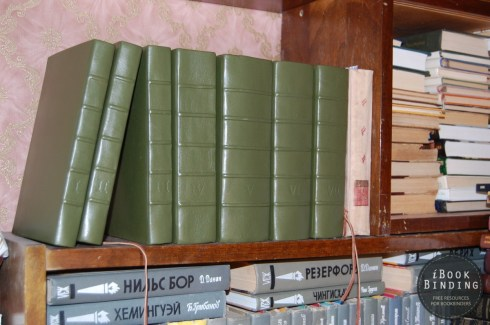 Seven Volumes of Harry Potter in Green Leather with Coat of Arms Embossed