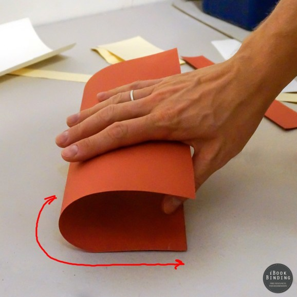 Determining grain direction by bending a sheet of paper. High resistance