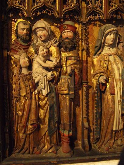 "The Altar of the ""Gertrudenbruderschaft der Träger"" (Gertrud brotherhood of the porters) from 1509 and it shows St. Anne and the Holy Kinship. Two of St. Annes relatives are carrying a girdle book. From http://buchwerkstatt.blogspot.ru/"