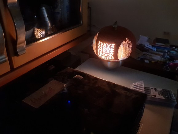 Halloween at iBookBinding - Transferring the logo to the pumpkin with a help of projector