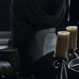 GoT S01E01 00.22.32 - A document in Maester Luwin's hands - close-up