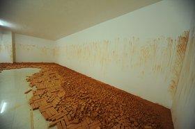 Latifa Echakhch, Tkaf, 2011, installation view, bricks and pigment. Courtesy of the artist and Kamel Mennour, Paris. Image courtesy of Sharjah Art Foundation.