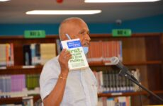 IBS Founder Sir Mick Nades holding the book 'first break all the rules' during the launching of the Gallup Clifton Strength finder.