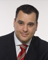 The Honourable James Moore, Canadian Minister of Industry