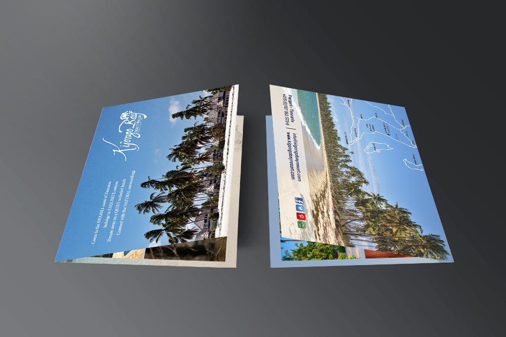 two colourful brochures against grey background