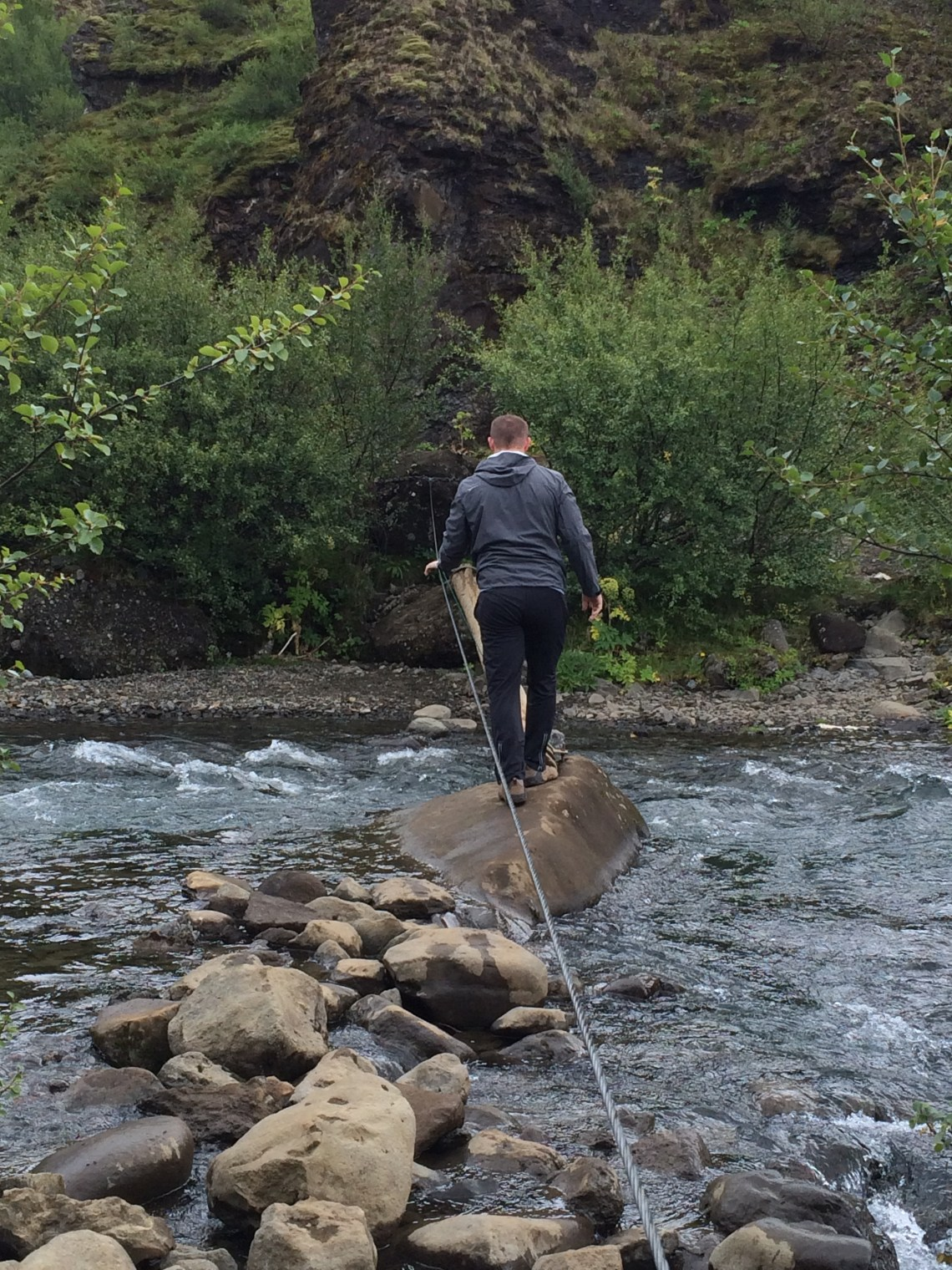 River crossing on a small log on the hike to Glymur Waterfall!