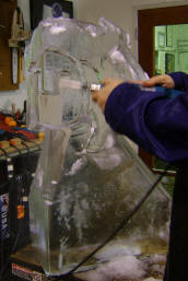Carving a face ice sculpture 6