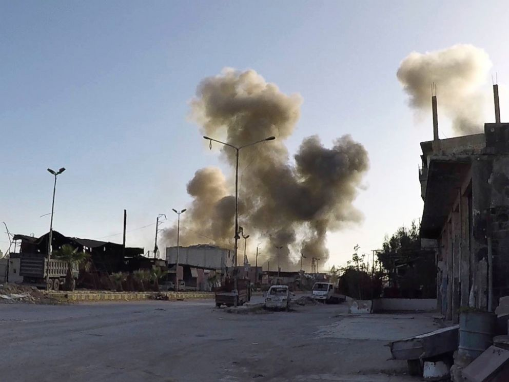 PHOTO: Smoke rising after Syrian government airstrikes hit in the town of Douma, in eastern Ghouta region east of Damascus, Syria, April. 7, 2018.