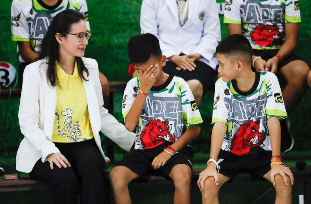 Rescued soccer player Titan Chanin Vibulrungruang reacts after paying respect to a portrait of Saman Gunan, the Thai Navy SEAL diver who died in the rescue attempt, during a press conference in Chiang Rai, Thailand, July 18, 2018.