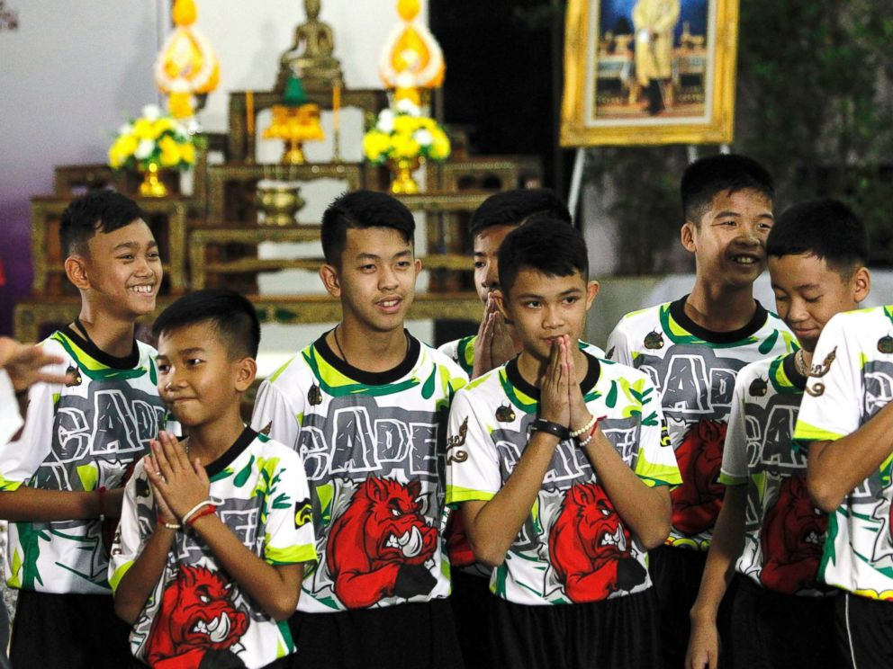 PHOTO: Some of the 12 members of the Wild Boar soccer team, who were rescued from the Tham Luang cave, greet the media at Chiang Rai Provincial Administrative Organization in Chiang Rai province, Thailand, July 18, 2018.