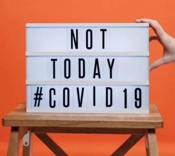 not-today-covid19-sign-on-wooden-stool-3952231-e1585152106267.jpg