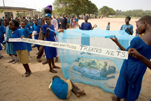 Some Nigeria school children performing a skit that aim at promoting the effectiveness of mosquito nets in preventing malaria. Photo credit: Mike Dubose/UMNS