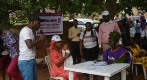 A woman brings her child for registration in Ondo State. Photo credit: NAN