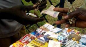Drug peddler exchanging drug with money in Ijora, Lagos