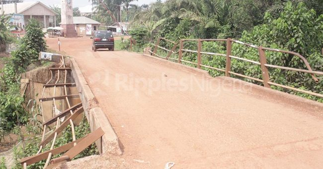 A bridge in the community has almost failed with bent hand rails as cars slowly navigate to avoid falling off. Photo by Patrick Egwu