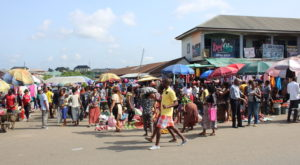 Traders selling on the roadside at Oil Mill market